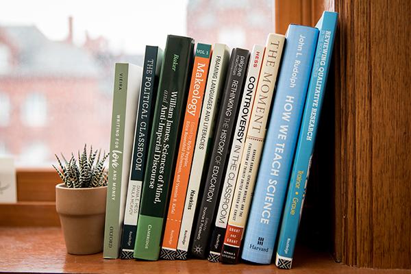 lineup of education books on a shelf