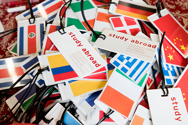 Pile of luggage tags showing flags from different countries